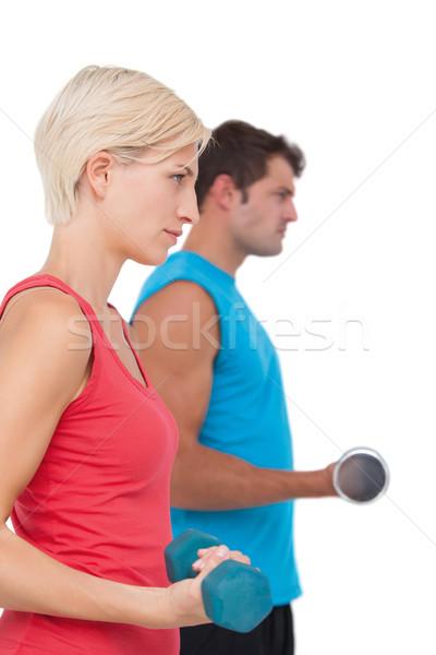 Encajar hombre mujer pesas blanco Foto stock © wavebreak_media