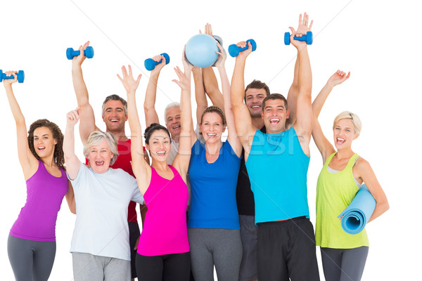 Excited people with exercise equipment raising hands Stock photo © wavebreak_media
