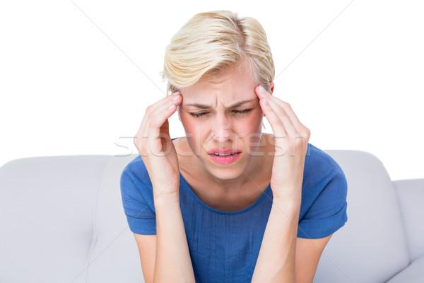 Attractive blonde woman having headache Stock photo © wavebreak_media