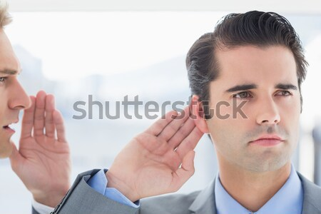 Businessman telling secret to his colleague Stock photo © wavebreak_media