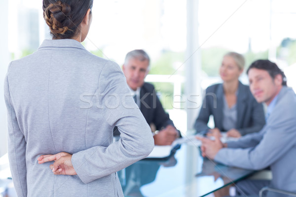 Businesswoman with fingers crossed behind her back Stock photo © wavebreak_media
