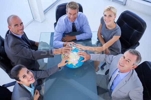 business people touching a globe   Foto stock © wavebreak_media