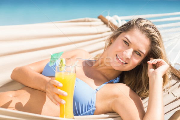 Pretty woman holding cocktail in the hammock  Stock photo © wavebreak_media