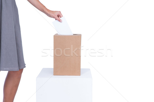 Businesswoman putting ballot in vote box  Stock photo © wavebreak_media