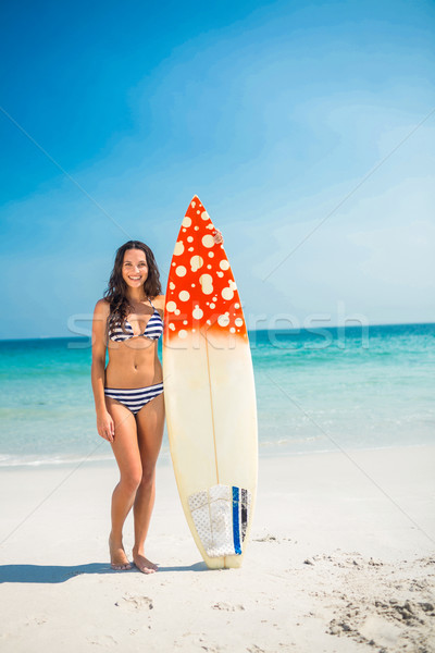 Pretty brunette with a surfboard on a sunny day Stock photo © wavebreak_media