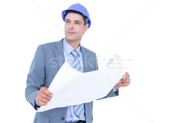 Businessman looking at a blueprint Stock photo © wavebreak_media