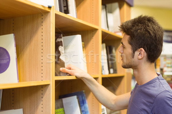 University student choosing books on bookshelves Stock photo © wavebreak_media
