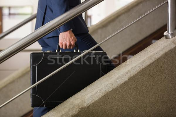 Işadamı tırmanma yukarı merdiven ofis binası Bina Stok fotoğraf © wavebreak_media