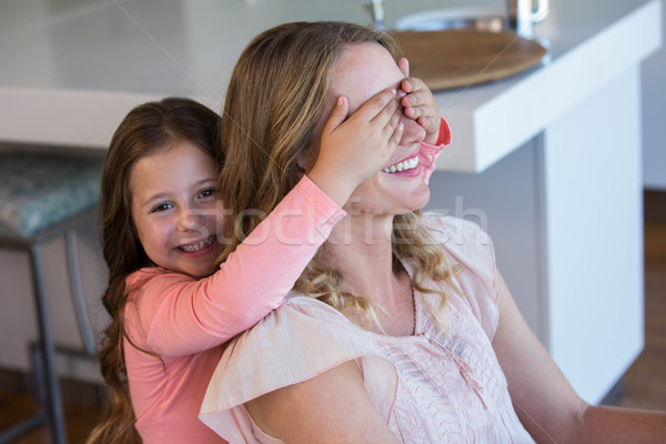 Happy little girl covering her mother eyes  Stock photo © wavebreak_media