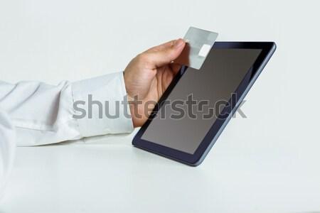 Man using tablet for online shopping Stock photo © wavebreak_media