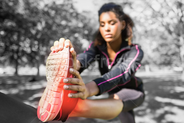 Highlighted ankle of stretching woman Stock photo © wavebreak_media