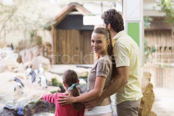 Happy family looking at penguins Stock photo © wavebreak_media
