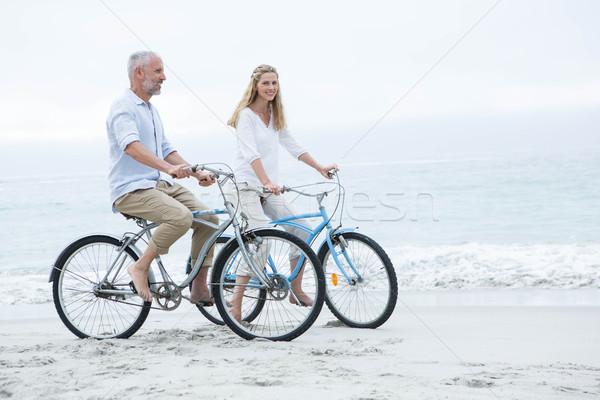 Felice Coppia ciclismo insieme spiaggia amore Foto d'archivio © wavebreak_media