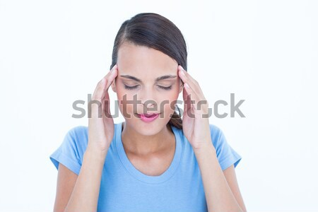 Pretty brunette with headache touching her temples  Stock photo © wavebreak_media