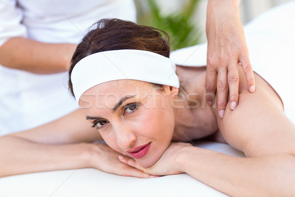 Beautiful brunette having back massage Stock photo © wavebreak_media