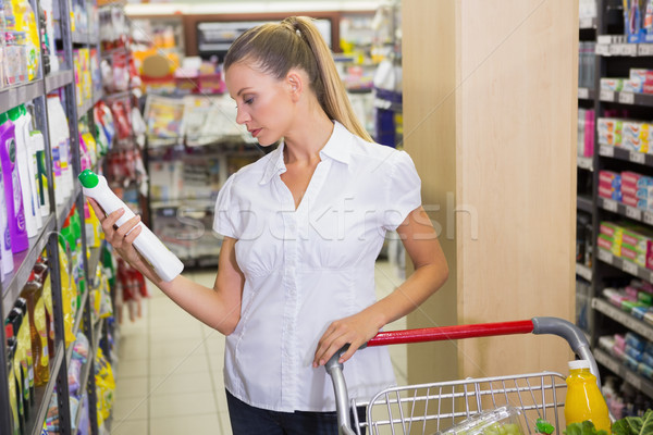 woman taking cleaning product in the shelf of aisle  Stock photo © wavebreak_media