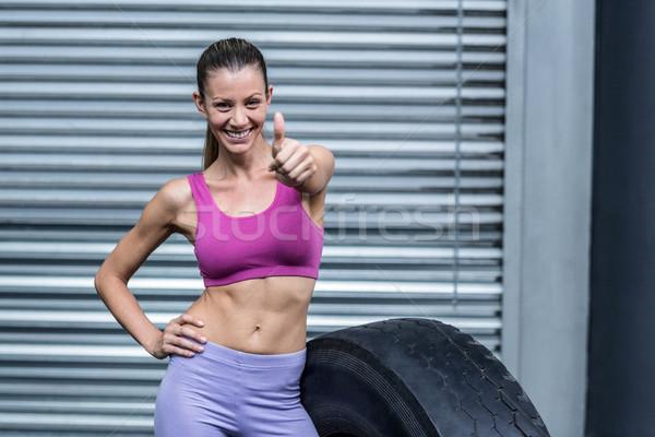 Uśmiechnięty muskularny kobieta portret Zdjęcia stock © wavebreak_media