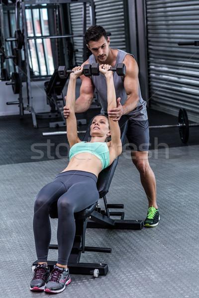 Muscular mujer pesas entrenador hombre Foto stock © wavebreak_media