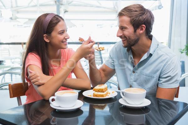 Young happy couple eating cake together Stock photo © wavebreak_media