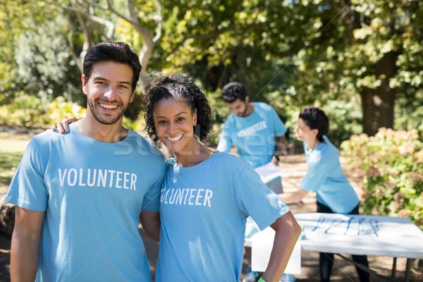 Sorridere volontari piedi parco ritratto computer Foto d'archivio © wavebreak_media