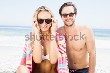 Stock photo: Portrait of couple wearing sunglasses at beach
