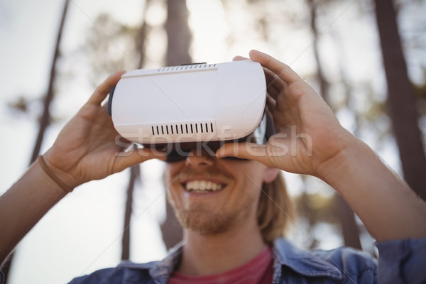 Young man wearing virtual reality simulator Stock photo © wavebreak_media