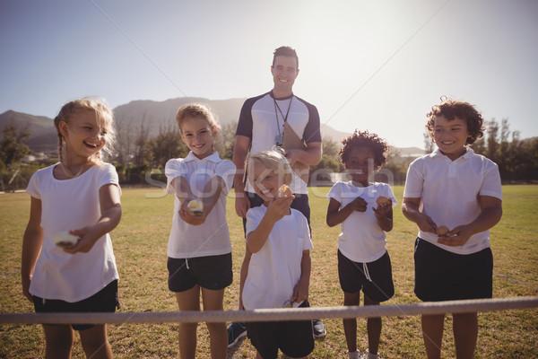 Szczęśliwy trenerem uczennice stałego line jaj Zdjęcia stock © wavebreak_media