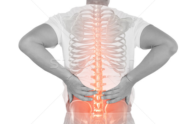 Digital composite of highlighted spine of man with back pain Stock photo © wavebreak_media