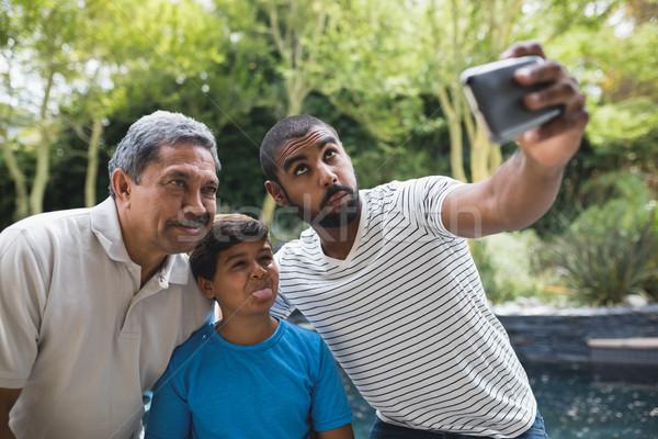 Happy multi-generation family making faces while taking selfie at park Stock photo © wavebreak_media