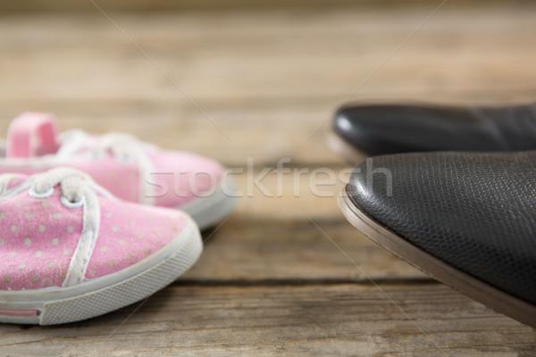 Közelkép rózsaszín fekete cipők padló fapadló Stock fotó © wavebreak_media