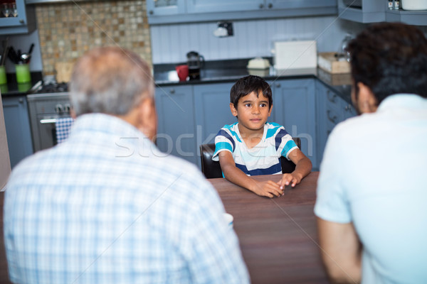 High angle view of father and grandfather talking to boy Stock photo © wavebreak_media