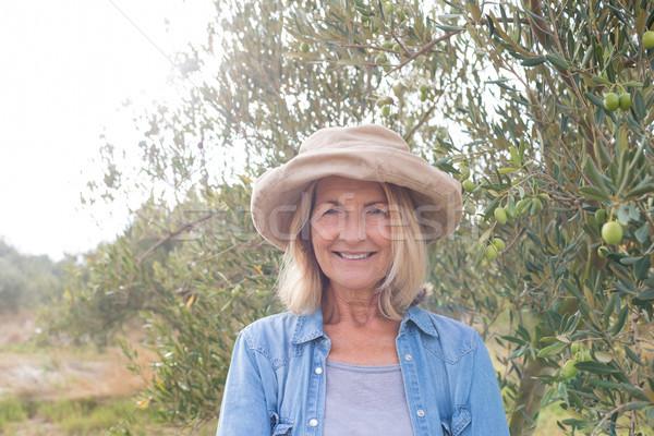 Portrait of happy woman standing in olive farm Stock photo © wavebreak_media