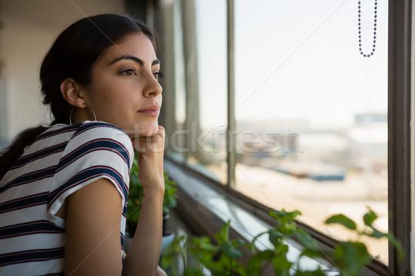 Zamyślony kobieta patrząc okno biuro młodych Zdjęcia stock © wavebreak_media
