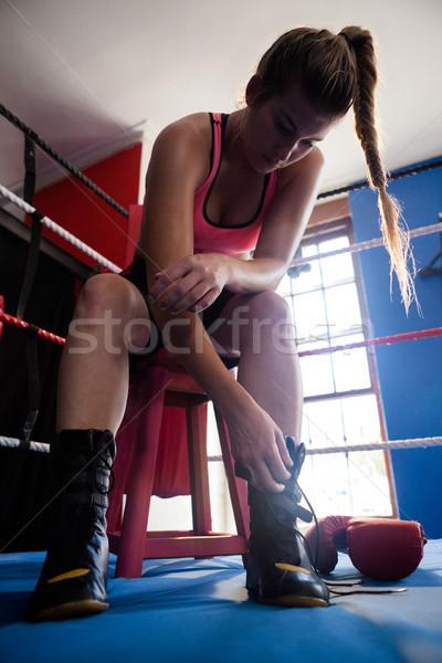 Woman wearing shoes in boxing ring Stock photo © wavebreak_media