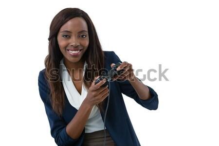 Portrait of businesswoman playing video game Stock photo © wavebreak_media