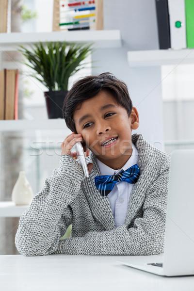 Smiling businessman talking on phone Stock photo © wavebreak_media
