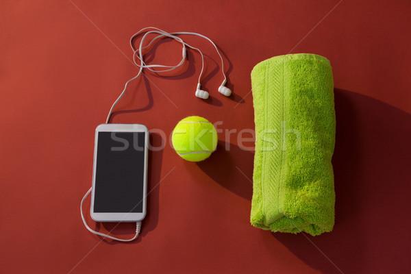 мнение теннисный мяч салфетку мобильного телефона наушники темно-бордовый Сток-фото © wavebreak_media