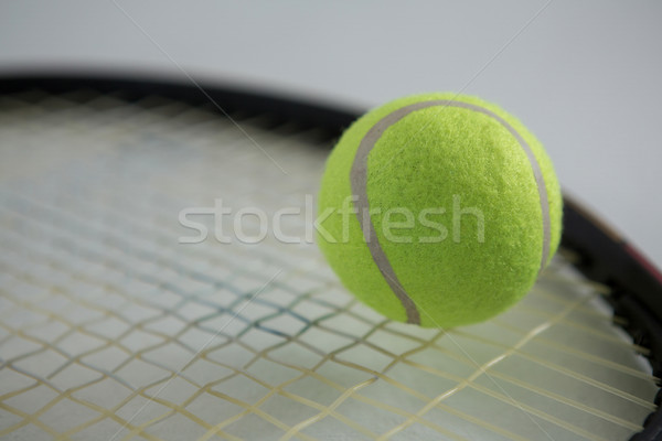 Close up of fluorescent tennis ball on racket Stock photo © wavebreak_media