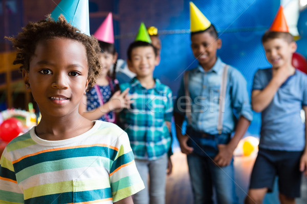 Portrait of girl wearing party hand with friends in background Stock photo © wavebreak_media