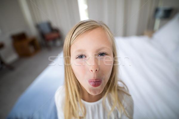 Portrait of girl pouting in bedroom Stock photo © wavebreak_media