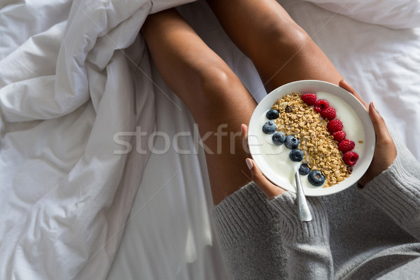 Mid section of woman having breakfast on bed Stock photo © wavebreak_media