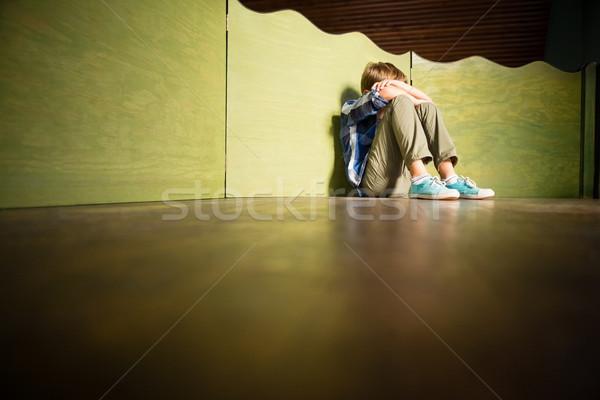 Sad boy sitting with head down Stock photo © wavebreak_media
