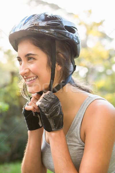 улыбаясь спортивный брюнетка шлема природы женщину Сток-фото © wavebreak_media