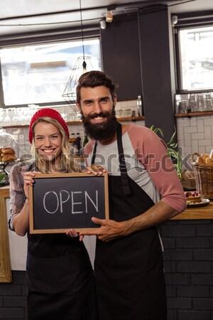 Man whispering in woman ear at cafe Stock photo © wavebreak_media