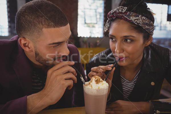 Friends enjoying milkshake Stock photo © wavebreak_media