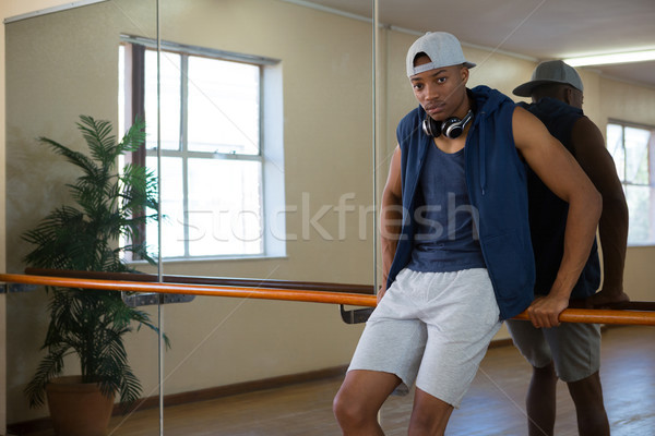 Stock photo: Portrait of male dancer leaning on barre