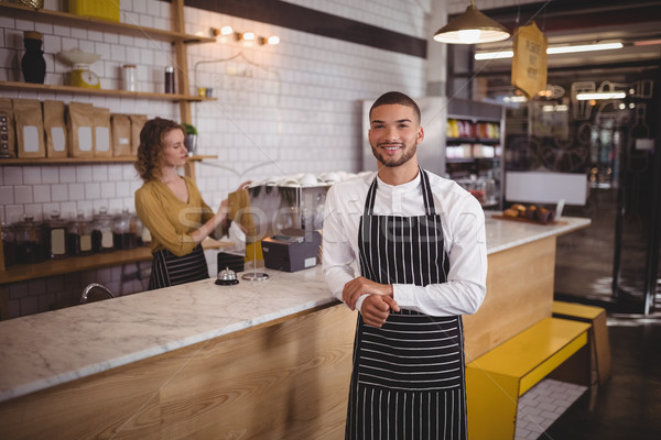 Portrait of waiter standing by counter at coffee shop Stock photo © wavebreak_media