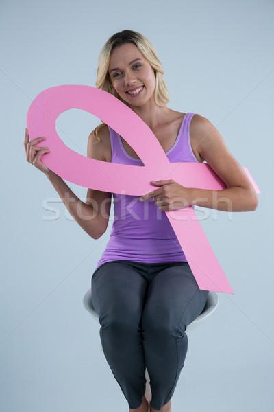 Portrait of smiling woman holding Breast Cancer Awareness ribbon Stock photo © wavebreak_media