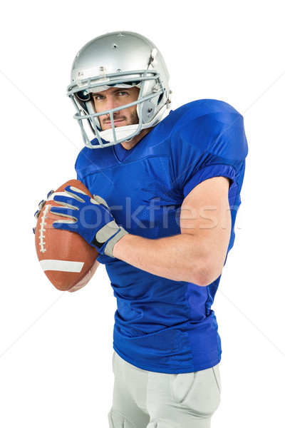 Confident sportsman to throwing the ball Stock photo © wavebreak_media