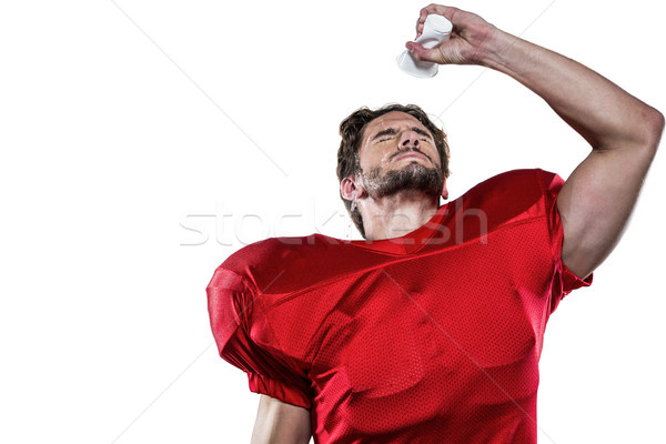 American football player in red jersey pouring water on face Stock photo © wavebreak_media